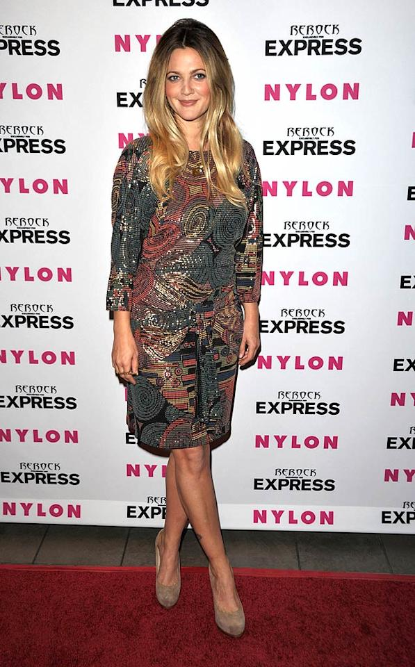"""Sporting a bouffant '60s-style hairdo, Drew Barrymore positively glowed in a mosaic chain mail frock and nude Yves St. Laurent platform pumps at the Nylon + Express August Denim Issue Party in West Hollywood Tuesday night. Where did Drew find her gorgeous dress? """"It was $25 and she bought it at a vintage store in Austin, Texas,"""" her rep told StyleList.com. John Shearer/<a href=""""http://www.wireimage.com"""" target=""""new"""">WireImage.com</a> - August 10, 2010"""