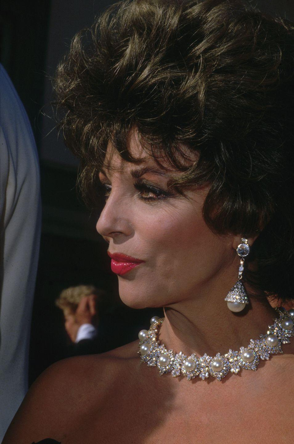 <p>This was the year that Dynasty finally beat rival drama Dallas to the top of the US television ratings, and Collins celebrated on the red carpet in suitably theatrical pearls and diamonds. </p>