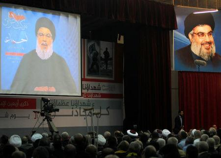 Lebanon's Hezbollah leader Sayyed Hassan Nasrallah is seen on a video screen as he addresses his supporters in Beirut, Lebanon November 10, 2017. REUTERS/Aziz Taher