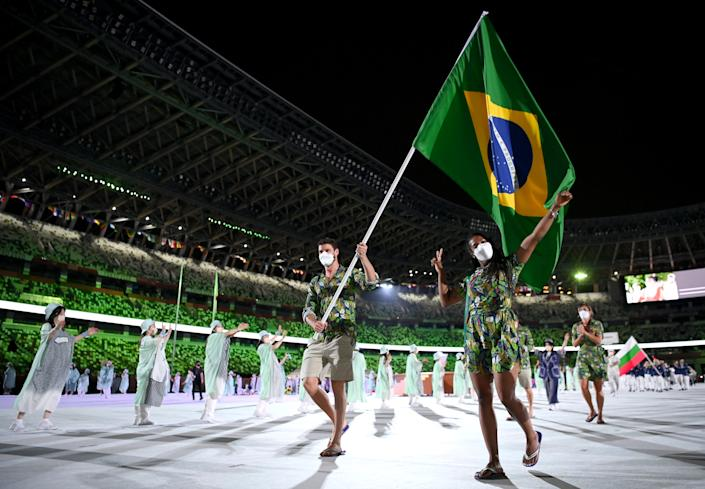 <p>TOKYO, JAPAN - JULY 23: Flag bearers Ketleyn Quadros and Bruno Mossa Rezende of Team Brazil lead their team out during the Opening Ceremony of the Tokyo 2020 Olympic Games at Olympic Stadium on July 23, 2021 in Tokyo, Japan. (Photo by Matthias Hangst/Getty Images)</p>