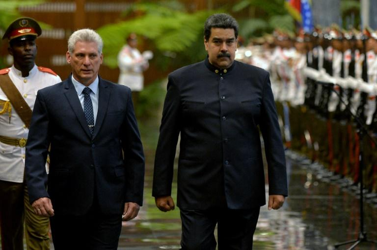 Sanctions imposed by Washington are a way for US President Donald Trump to punish Havana for its support of Venezuela President Nicolas Maduro (R)