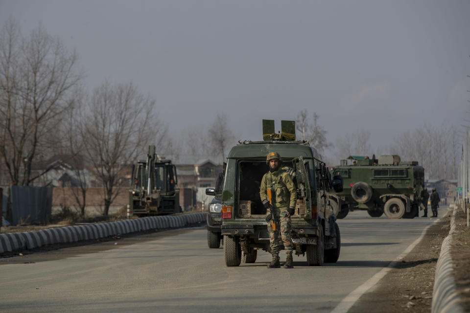 Indian army soldiers stand guard near the site of a gun battle on the outskirts of Srinagar, Indian controlled Kashmir, Wednesday, Dec. 30, 2020. A gun battle between rebels and government forces overnight killed three rebels on the outskirts of Srinagar on Wednesday, officials said. (AP Photo/Dar Yasin)