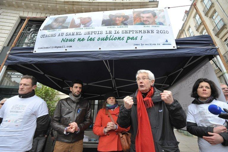 "Relatives of Pierre Legrand, one of four French hostages being held by Al-Qaeda's north African branch , gather on March 2, 2013 in Nantes. The hostages' families are urging the French government to show a ""willingness to negotiate"" with the militant group"