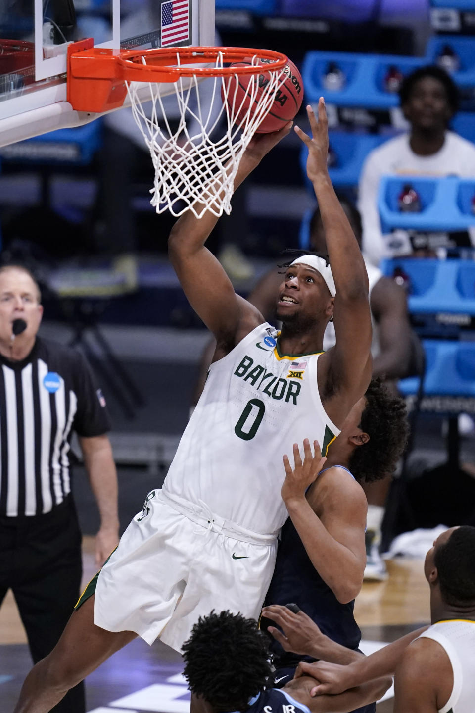 FILE - Baylor forward Flo Thamba (0) shoots against Villanova in the second half of a Sweet 16 game in the NCAA men's college basketball tournament at Hinkle Fieldhouse in Indianapolis, in this Saturday, March 27, 2021, file photo. All-American junior Jared Butler and his backcourt mates Davion Mitchell and MaCio Teague pretty much get all of the attention for the top-seeded Bears (26-2), who play a former Southwest Conference rival in the first national semifinal game Saturday. But those guards know they wouldn't be where they are now without the often interchangeable 245-pound post players _ the 6-foot-10 Thamba and and 6-8 Tchamwa Tchatchoua. (AP Photo/Michael Conroy, File)