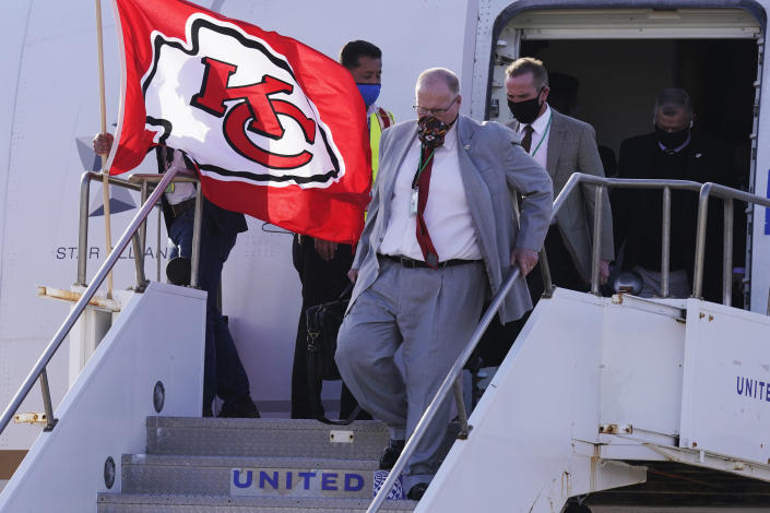 Kansas City Chiefs head coach Andy Reid arrives with his team for the NFL Super Bowl 55 football game against the Tampa Bay Buccaneers, Saturday, Feb. 6, 2021, in Tampa, Fla. (AP Photo/Charlie Riedel)