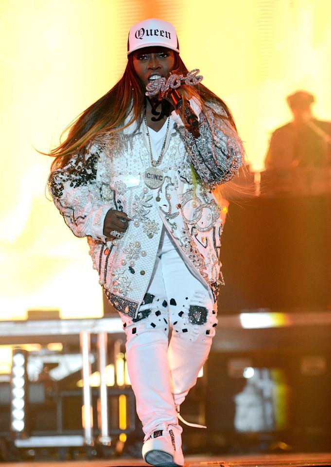 """Missy let her accessories speak volumes when she wore an """"ICONIC"""" necklace and a """"QUEEN"""" trucker hat during a performance in 2017, pairing them with an equally sparkly white bedazzled jacket and white skinny jeans."""