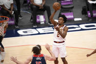 Cleveland Cavaliers guard Collin Sexton (2) shoots against Washington Wizards center Robin Lopez, bottom, during the second half of an NBA basketball game, Friday, May 14, 2021, in Washington. The Wizards won 120-105. (AP Photo/Nick Wass)