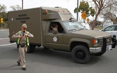 A sheriff's hostage negotiation team passes a California highway patrol checkpoint at the Veterans Home of California in Yountville - Credit: AP