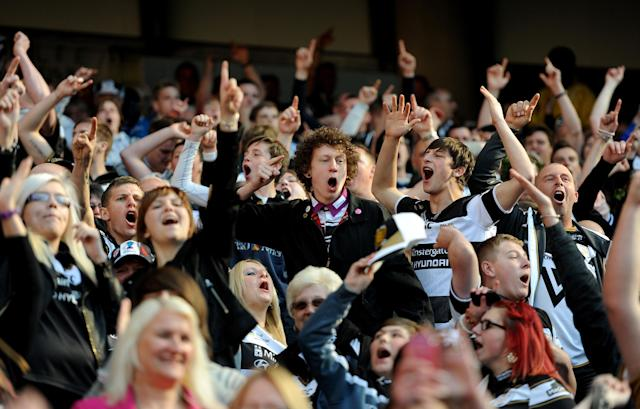Hull FC fans celebrate in the stands during the Super League Magic Weekend at the Etihad Stadium, Manchester.