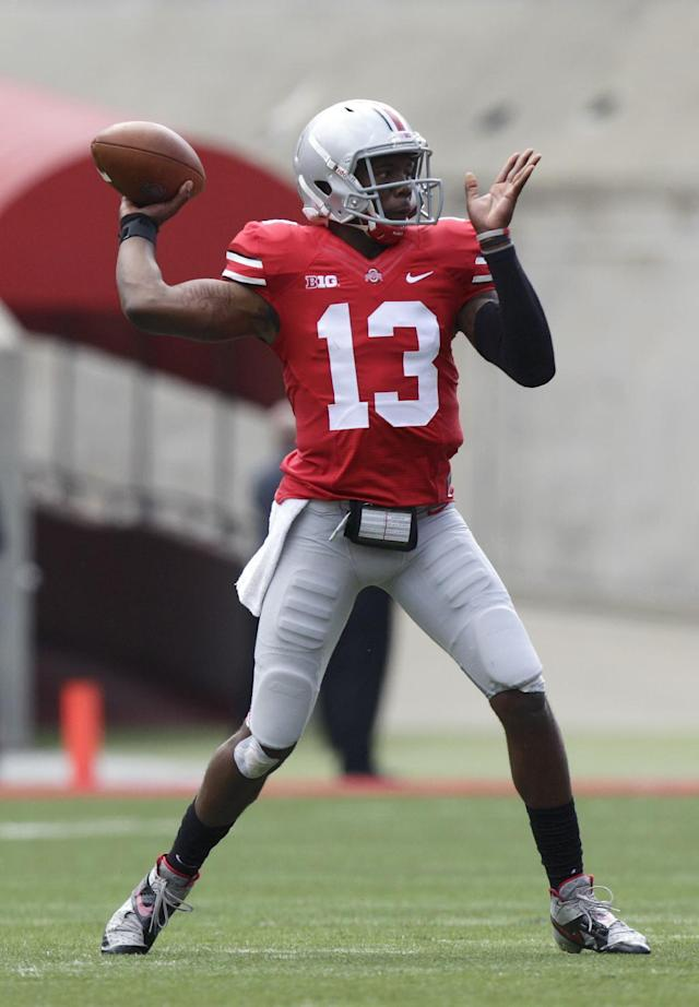 Ohio State quarterback Kenny Guiton throws a pass against Florida A&M during the first quarter of an NCAA college football game Saturday, Sept. 21, 2013, in Columbus, Ohio. (AP Photo/Jay LaPrete)