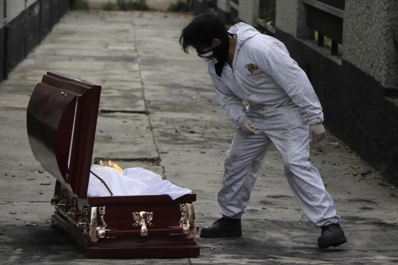A coffin belonging to a person killed by Covid-19 is opened to verify that there is nothing inside and later to be cremated in the San Nicolas Tolentino crematorium, Iztapalapa, Mexico City, Mexico, on June 12, 2020. (Photo by Gerardo Vieyra/NurPhoto via Getty Images)