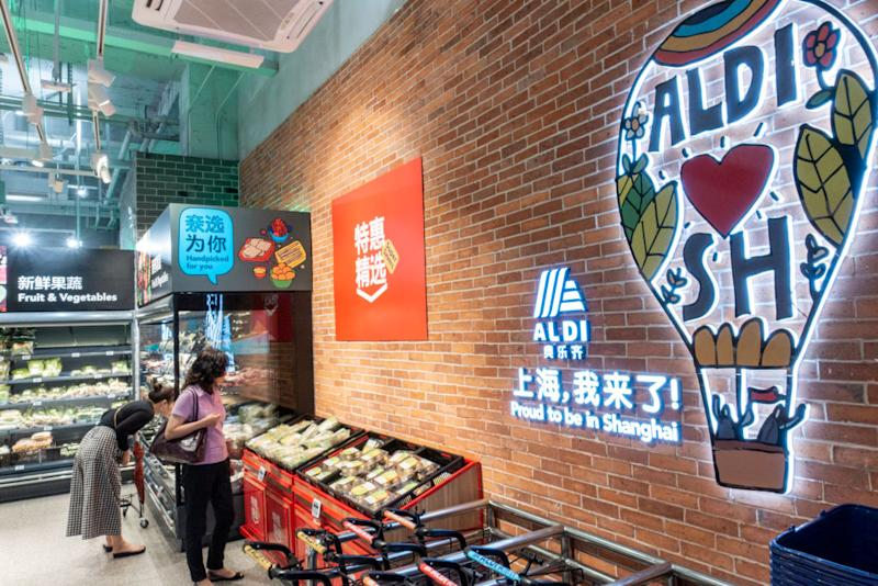 Aldi shoppers looking at produce in a Shanghai store in China.