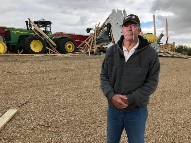 Eugene Zakaluzny 66, owns a farm near Hodgeville, Sask. He says he looked out a window of his house on Monday evening and saw farm equipment flying.  (Richard Agecoutay/CBC - image credit)