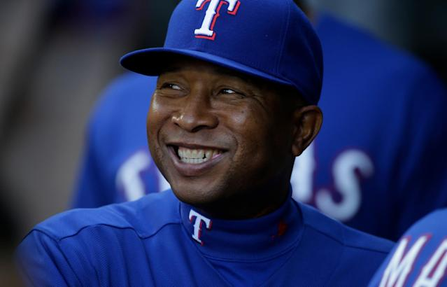 Rangers third-base coach Tony Beasley is back with the team after beating cancer. (AP Images)
