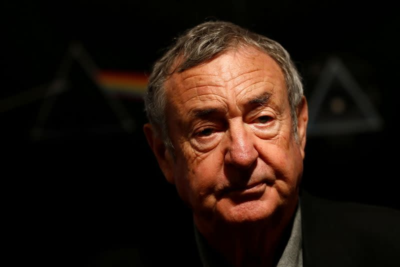 FILE PHOTO: Nick Mason of Pink Floyd poses for photographers at Bonhams auctioneers in London