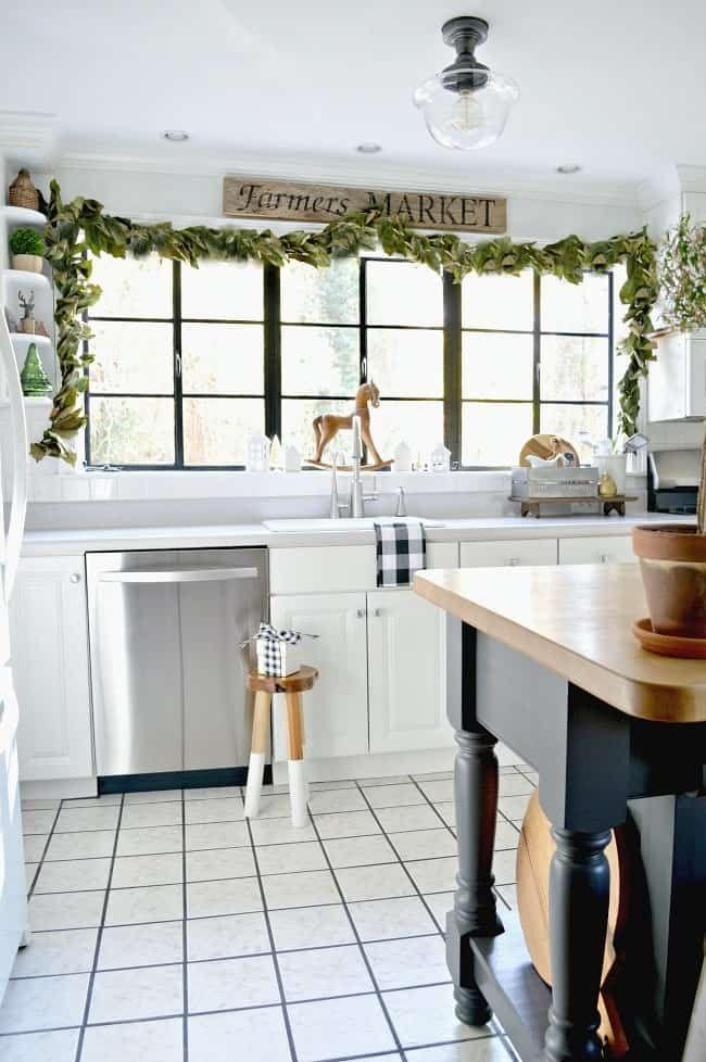 """<p>Whether you decide to use this magnolia leaf garland on your inside or outside windows, it definitely adds a farmhouse feel. </p><p><strong>Get the tutorial at <a href=""""https://www.chatfieldcourt.com/diy-magnolia-leaf-garland/"""" rel=""""nofollow noopener"""" target=""""_blank"""" data-ylk=""""slk:Chatfield Court"""" class=""""link rapid-noclick-resp"""">Chatfield Court</a>.</strong></p><p><strong><a class=""""link rapid-noclick-resp"""" href=""""https://www.amazon.com/Napa-Home-Garden-MAGNOLIA-PICK/dp/B01GL04A1M/?tag=syn-yahoo-20&ascsubtag=%5Bartid%7C10050.g.23343056%5Bsrc%7Cyahoo-us"""" rel=""""nofollow noopener"""" target=""""_blank"""" data-ylk=""""slk:SHOP MAGNOLIA LEAVES"""">SHOP MAGNOLIA LEAVES</a><br></strong></p>"""
