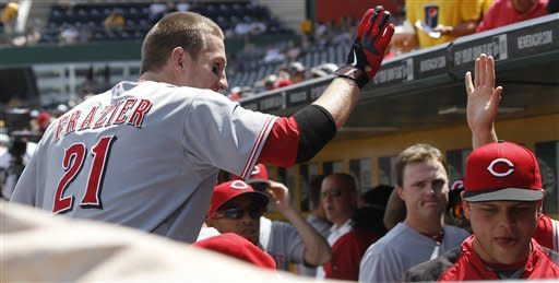 Cincinnati Reds' Todd Frazier (21) is greeted in the dugout after hitting a solo home run in the second inning of the baseball game against the Pittsburgh Pirates on Sunday, May 6, 2012, in Pittsburgh. (AP Photo/Keith Srakocic)