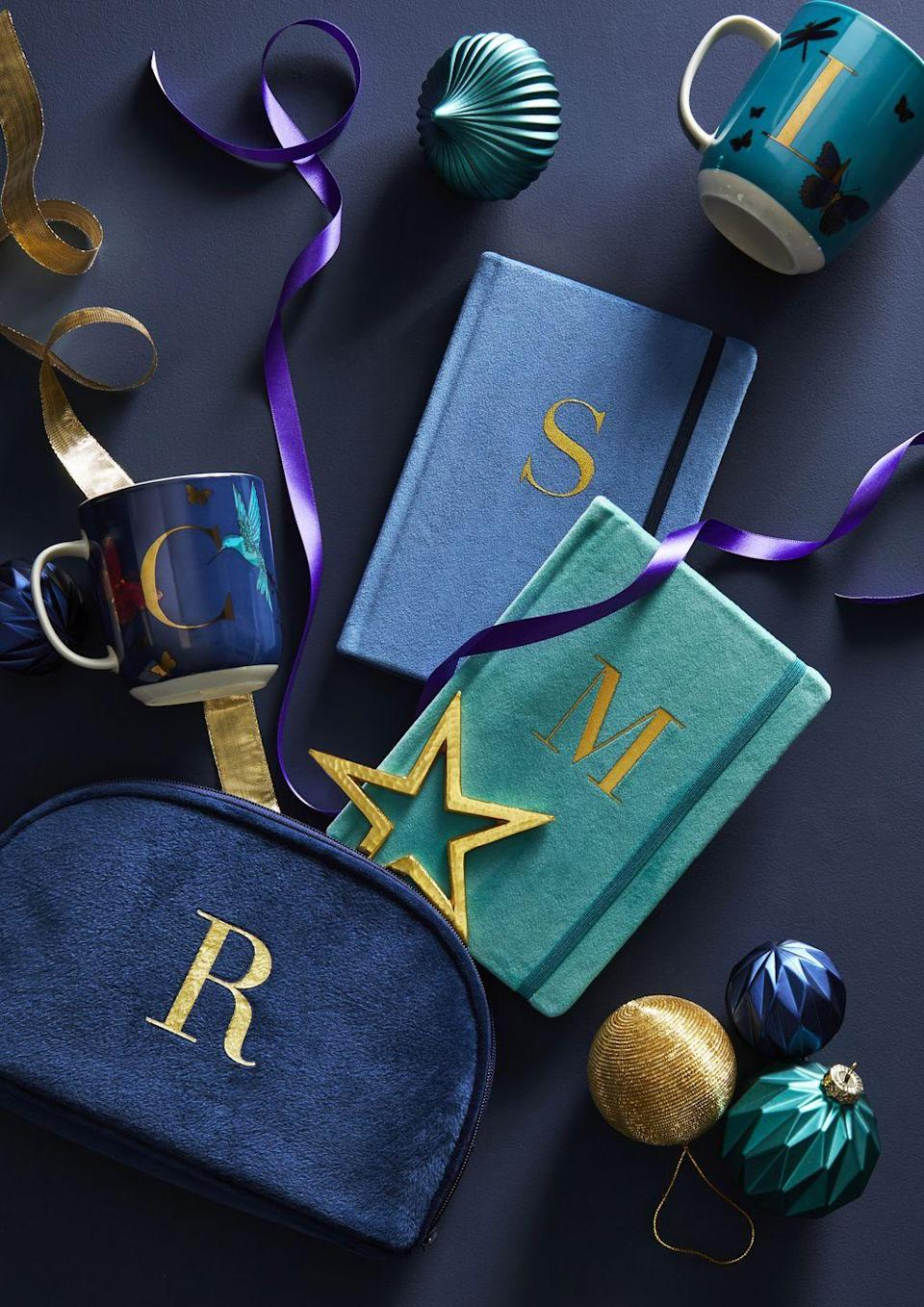 <p>Not sure what to gift your loved ones this year? Why not make it personal with Dunelm's range of monogrammed notebooks, mugs and cosmetic bags. In deep shades of teal and blue, they're the ultimate way to make a statement. </p>
