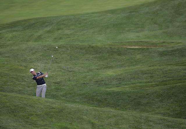 Webb Simpson hits from rough on the 13th hole during a practice round for the PGA Championship golf tournament at Valhalla Golf Club on Tuesday, Aug. 5, 2014, in Louisville, Ky. The tournament is set to begin on Thursday. (AP Photo/David J. Phillip)