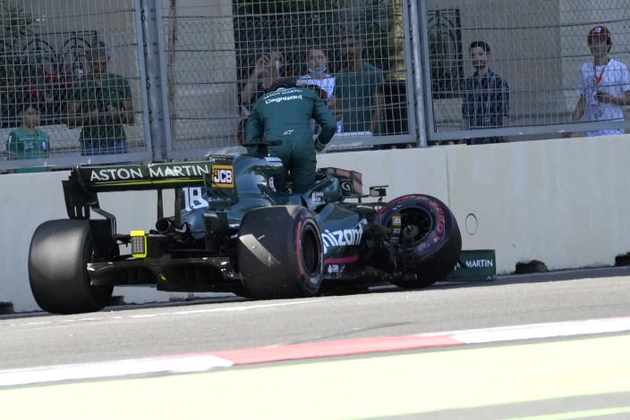 Aston Martin driver Lance Stroll of Canada gets out of his car after a crash during the qualifying session at the Baku Formula One city circuit in Baku, Azerbaijan, Saturday, June 5, 2021. The Azerbaijan Formula One Grand Prix will take place on Sunday. (AP Photo/Darko Vojinovic)