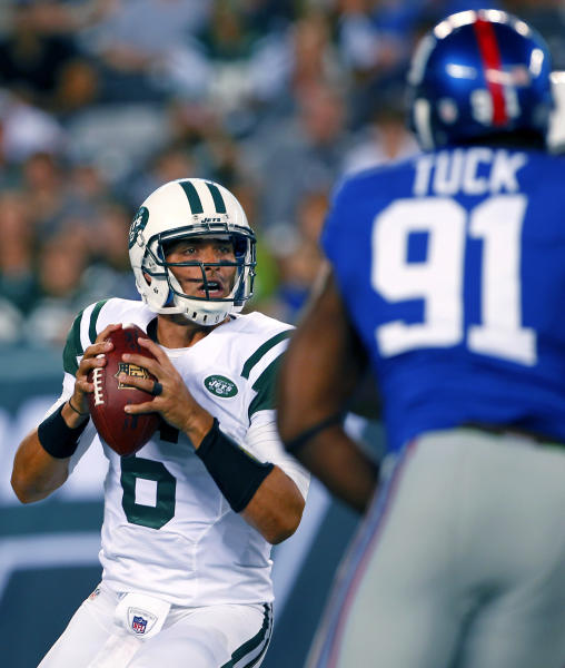 New York Jets quarterback Mark Sanchez (6) passes under pressure from New York Giants defensive end Justin Tuck (91) during the first half of a preseason NFL football game on Saturday, Aug. 18, 2012, in East Rutherford, N.J. (AP Photo/Rich Schultz)