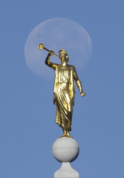 FILE - In this Sept. 11, 2014, file photo, the angel Moroni statue sits atop the Salt Lake Temple of The Church of Jesus Christ of Latter-day Saints at Temple Square in Salt Lake City. The Church of Jesus Christ of Latter-day Saints is reminding members that coffee is prohibited no matter how fancy the name, that vaping is banned despite the alluring flavors and that marijuana is outlawed unless prescribed by a competent doctor. (AP Photo/Rick Bowmer, File)