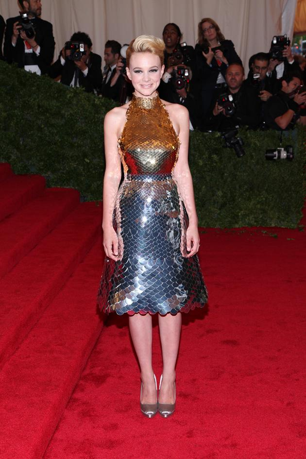 Carey Mulligan opted for a fish scale effect in her metallic Prada dress / WENN