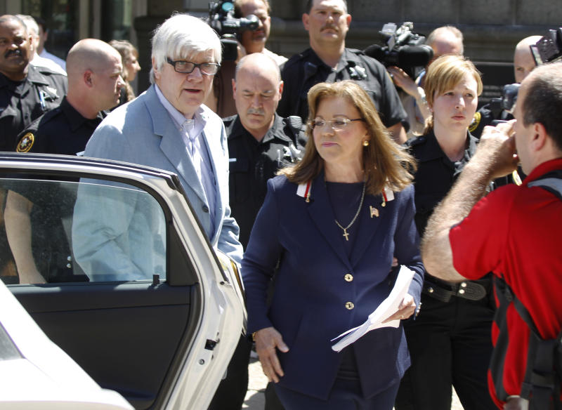 Pennsylvania Supreme Court Justice Joan Orie Melvin, center, leaves Pittsburgh Municipal Court after a hearing on charges she illegally used her state-funded staff to perform campaign work on Friday, May 18, 2012 in Pittsburgh. Orie Melvin said that she is not guilty of campaign corruption charges connected to her bids for a seat on the high court. (AP Photo/Keith Srakocic)