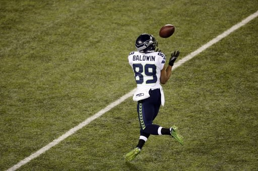 Seattle Seahawks' Doug Baldwin (89) makes a catch during the first half of the NFL Super Bowl XLVIII football game against the Denver Broncos Sunday, Feb. 2, 2014, in East Rutherford, N.J. (AP Photo/Charlie Riedel)