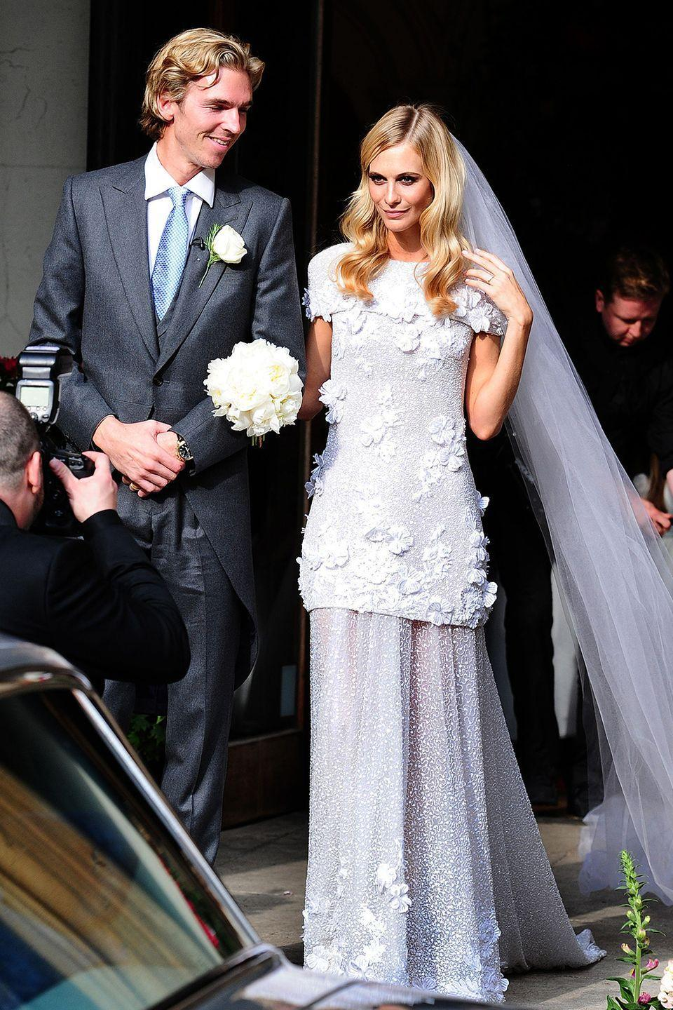 <p>Poppy married James Cook at St. Paul's Church in London. She went with a unique, '30s-inspired custom-made Chanel haute couture gown. Fun fact — Blake Lively wore a similar version of the dress back in 2009, but on the red carpet, not down the wedding aisle. </p>