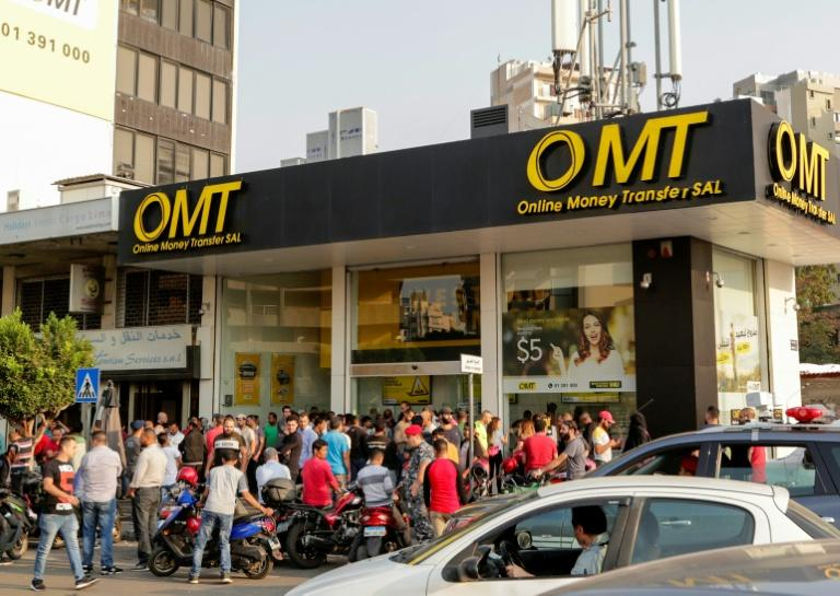 A big queue formed outside this money transfer shop in Beirut (AFP Photo/ANWAR AMRO)