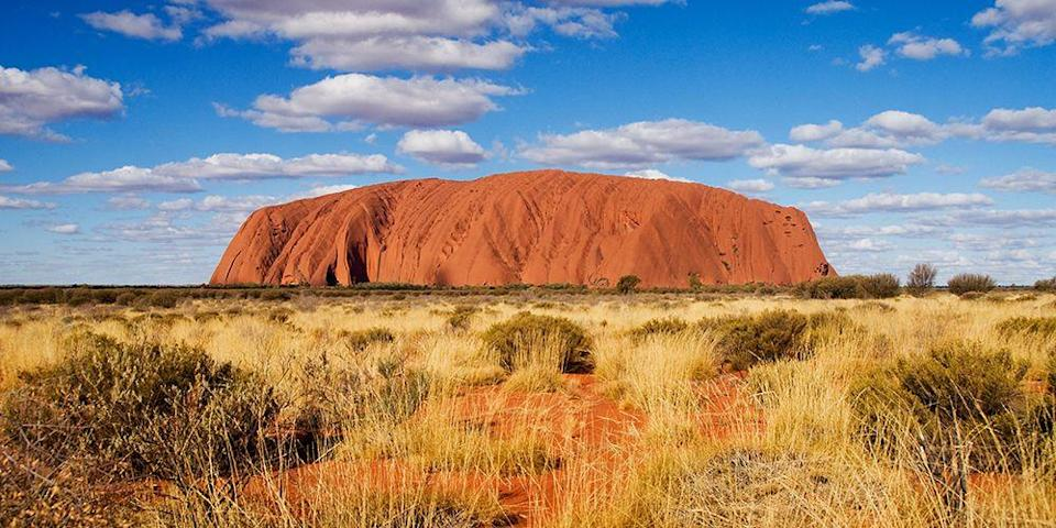 """<p>Ayers Rock, also known by its aboriginal name, <a href=""""https://www.tripadvisor.com/Attraction_Review-g256205-d256763-Reviews-Uluru-Uluru_Kata_Tjuta_National_Park_Red_Centre_Northern_Territory.html"""" rel=""""nofollow noopener"""" target=""""_blank"""" data-ylk=""""slk:Uluru"""" class=""""link rapid-noclick-resp"""">Uluru</a>, is the centerpiece of Uluru-Kata Tjuta National Park, <a href=""""https://www.fodors.com/news/photos/fodors-go-list-2019"""" rel=""""nofollow noopener"""" target=""""_blank"""" data-ylk=""""slk:named a top destination of 2019"""" class=""""link rapid-noclick-resp"""">named a top destination of 2019</a>. This massive sandstone monolith, in one of the most remote outback areas of the country, is sacred to the local Anangu aboriginal people.</p><p>Take a hike around the base, where you can see its canyons and caves and learn more about its history and legends. Be sure to stick around for sunset when the rock glows a deep rusty red color. </p>"""