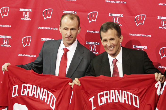 """FILE - University of Wisconsin men's NCAA hockey team assistant coach Don Granato, left, and head coach Tony Granato hold jerseys during an introductory press conference in Madison, Wisc., in this March 30, 2016, file photo. Though Don trails in the Granato family hockey pecking order behind Tony, who played 13 NHL seasons, and sister Cammi, a two-time Olympian, first female Hockey Hall of Fame inductee and NHL-expansion Seattle scout, Don Granato, now the Buffalo Sabres interim coach, became known by his siblings as """"the smart one."""" (Amber Arnold/Wisconsin State Journal via AP, File)"""