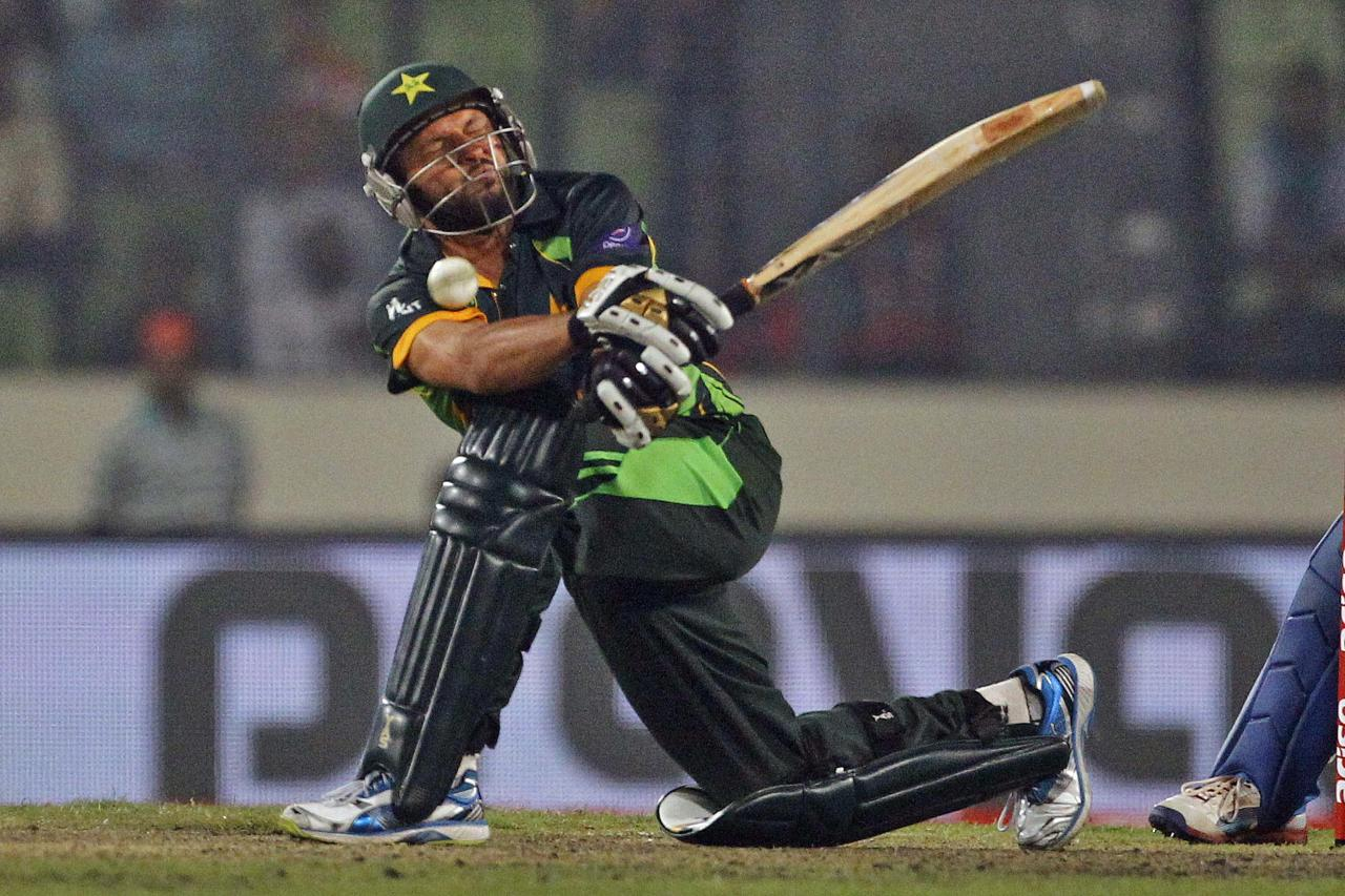 Pakistan's Shahid Afridi plays a shot during the Asia Cup one-day international cricket tournament against India in Dhaka, Bangladesh, Sunday, March 2, 2014. Pakistan won by 1 wicket. (AP Photo/A.M. Ahad)