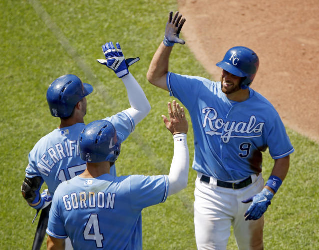 Kansas City Royals' Drew Butera (9) celebrates with Alex Gordon (4) and Whit Merrifield after hitting a three-run inside-the-park home run during the seventh inning of a baseball game against the Minnesota Twins, Sunday, July 22, 2018, in Kansas City, Mo. (AP Phot0/Charlie Riedel)