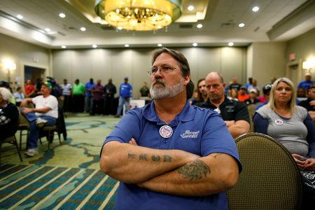 International Brotherhood of Electrical Workers representative James Hollman of Pineville, S.C., listens during a rally held by The International Association of Machinists and Aerospace Workers for Boeing South Carolina workers before Wednesday's vote to organize, in North Charleston, South Carolina, U.S. February 13, 2017.  REUTERS/Randall Hill