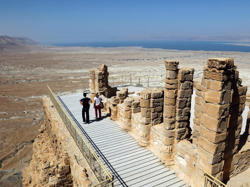 President George W. Bush and President Bill Clinton took a cable car to visit the ancient hilltop fortress of Masada in the Judean desert: MENAHEM KAHANA/AFP/Getty Images