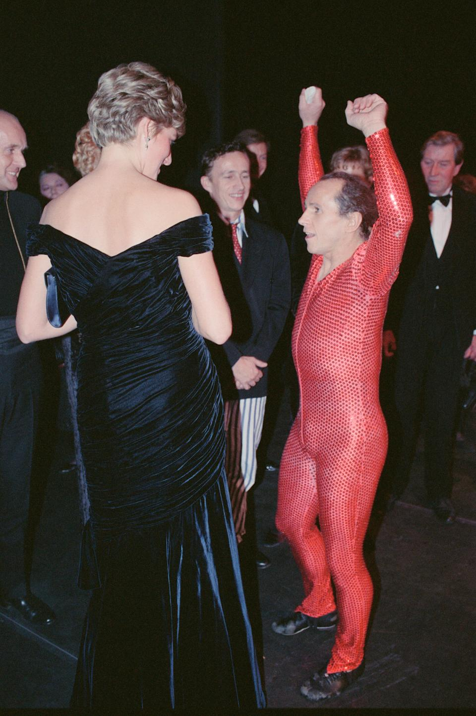 Princess Diana, Princess of Wales, attends Carnival of the Birds for the RSPB Charity, Royal Opera House, Covent Garden, London, Britain. Diana is introduced to the cast by dancer Wayne Sleep, who is dressed in the red leotard stage costume Picture taken 3rd November 1991. (Photo by Ken Lennnox/Mirrorpix/Getty Images)