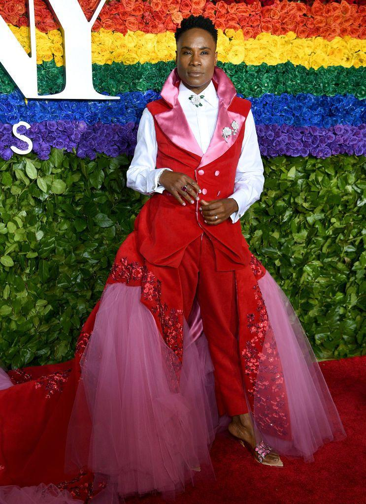<p>Porter at the 73rd Annual Tony Awards in a red velvet double-breasted vest, matching trousers, and pink chiffon skirt with floral appliqués. </p>
