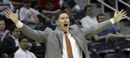 Clemson coach Brad Brownell reacts to play during the first half of an NCAA college basketball game against the Virginia Tech in the first round of the men's Atlantic Coast Conference tournament, Thursday, March 8, 2012, in Atlanta. (AP Photo/Chuck Burton)
