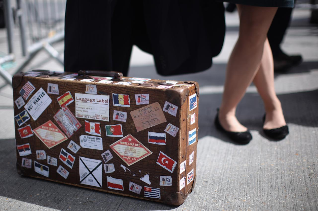 A reporter interviews a man with replica luggage beside birth 43 and 44 at Southampton Dock ahead of a Titanic Centenary Memorial on April 10, 2012 in Southampton, England. The births mark the departure point of RMS Titanic when it set sail one hundred years ago today. The maiden voyage of the ill-fated passenger liner Titanic ended when she sank after hitting an iceberg in the Atlantic on the night of April 14, 1911 with the loss of 1517 lives.  (Photo by Dan Kitwood/Getty Images)