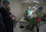 Doctors perform surgery in a basement of a hospital during shelling by Azerbaijan's artillery in Stepanakert, the separatist region of Nagorno-Karabakh, Wednesday, Oct. 28, 2020. Nagorno-Karabakh officials said Azerbaijani forces hit Stepanakert, the region's capital, and the nearby town of Shushi with the Smerch long-range multiple rocket systems, killing one civilian and wounding two more. (AP Photo)
