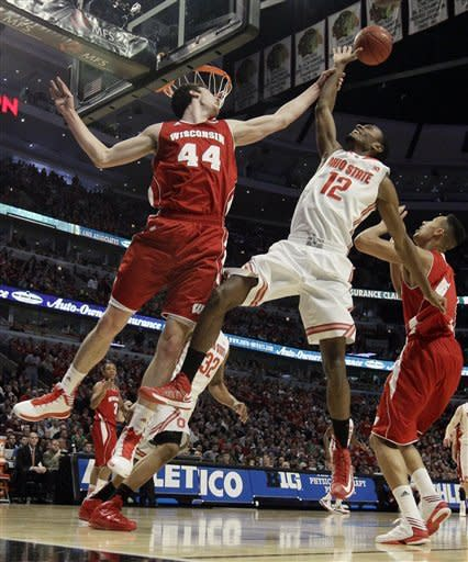 Wisconsin forward Frank Kaminsky (44) and Ohio State forward Sam Thompson (12) battle for a rebound during the first half of an NCAA college basketball game in the championship of the Big Ten tournament Sunday, March 17, 2013, in Chicago. At right is Wisconsin forward Ryan Evans. (AP Photo/Nam Y. Huh)