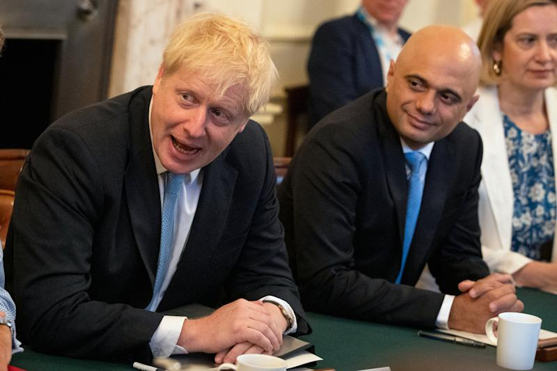 Britain's Chancellor of the Exchequer Sajid Javid (centre) and Secretary of State for Work and Pensions Amber Rudd with Prime Minister Boris Johnson (left) as he holds his first Cabinet meeting at Downing Street in London, Britain July 25, 2019. Aaron Chown/Pool via REUTERS
