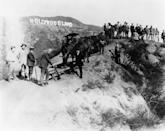 <p>The Hollywoodland sign was erected just two years before this photo was taken, as a means of encouraging people to live in the suburban housing development with that same name. </p>