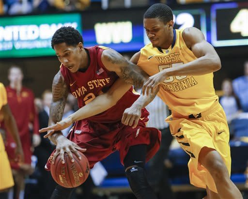 West Virginia's Keaton Miles, right, fouls Iowa State's Will Clyburn in the second half of an NCAA college basketball game at WVU Coliseum in Morgantown, W.Va., Saturday, March 9, 2013. Iowa State won 83-74. (AP Photo/David Smith)