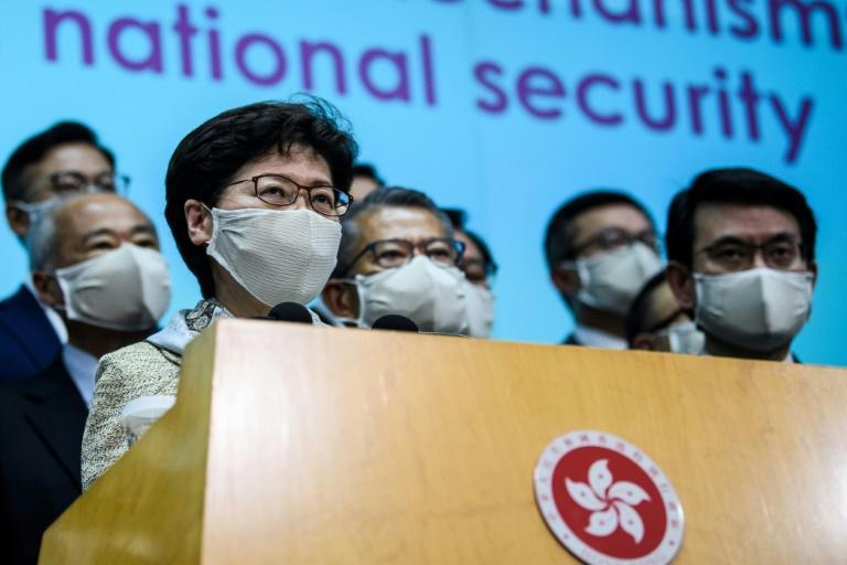 Hong Kong Chief Executive Carrie Lam (front L) insists the security law imposed by Beijing was necessary to restore order after huge and often violent democracy protests