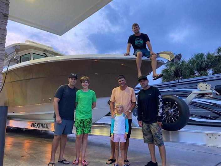 Joshua Yablon, Dylan Yablon, Tory Veigle, Beckham Veigle, Trey Krits and Drew McGucking stand by Veigle's boat outside the Race Trac gas station and convenience store in Florida City Wednesday, July 28, 2021.