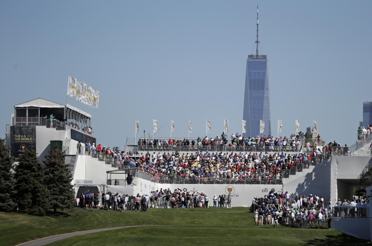 <p>The crowd watches the opening ceremony on the first tee before the first round of the Presidents Cup at Liberty National Golf Club in Jersey City, N.J., Sept. 28, 2017. (Photo: Julio Cortez/AP) </p>