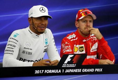 Mercedes' Lewis Hamilton of Britain attends a news conference after getting pole position in qualifying with Ferrari's Sebastian Vettel of Germany. REUTERS/Toru Hanai/File Photo